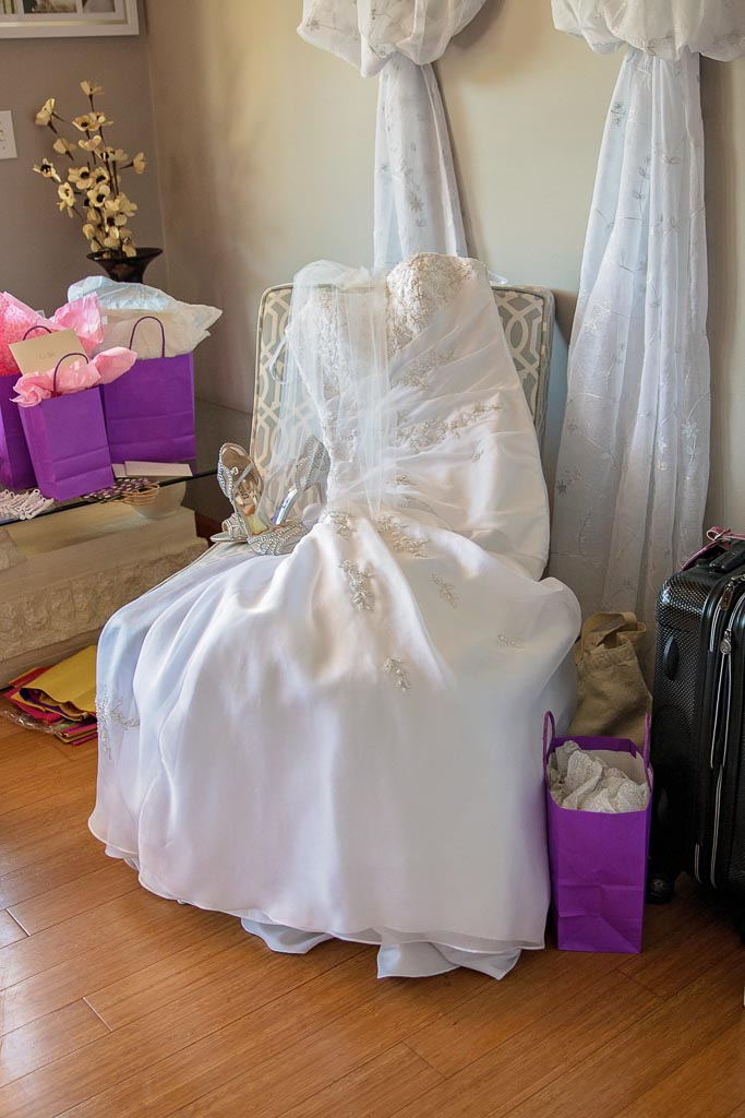 wedding dress laying on chair