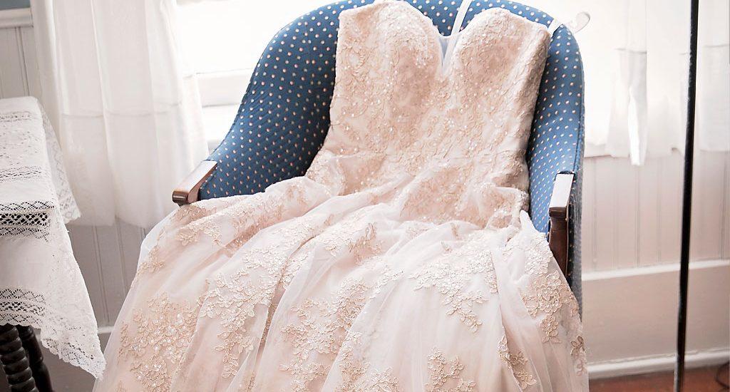 wedding dress on chair by window