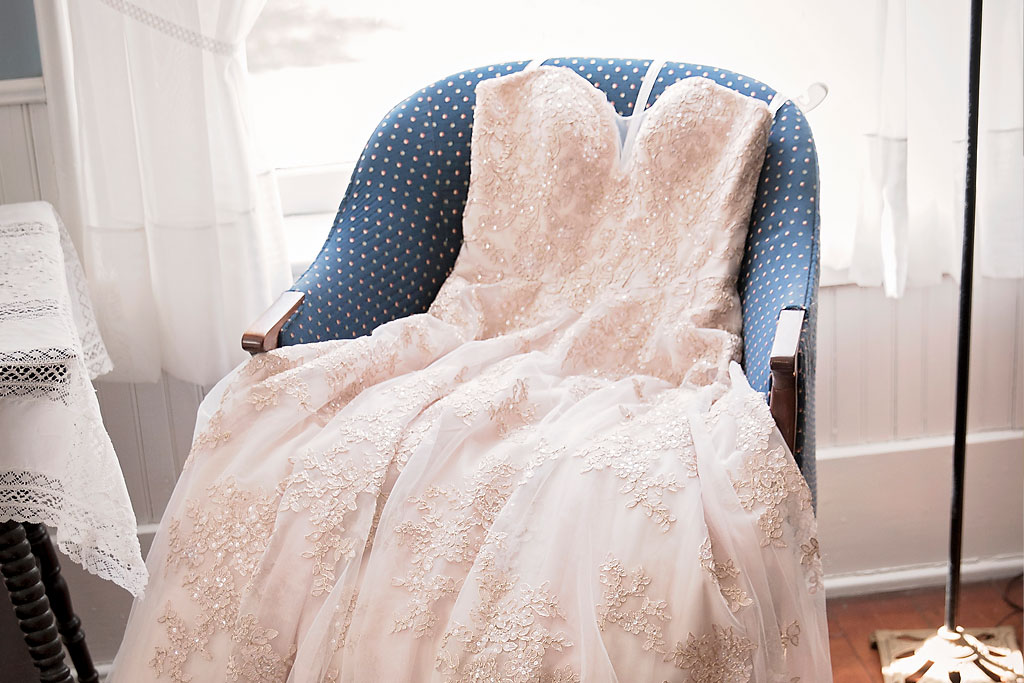 wedding dress on chair by window