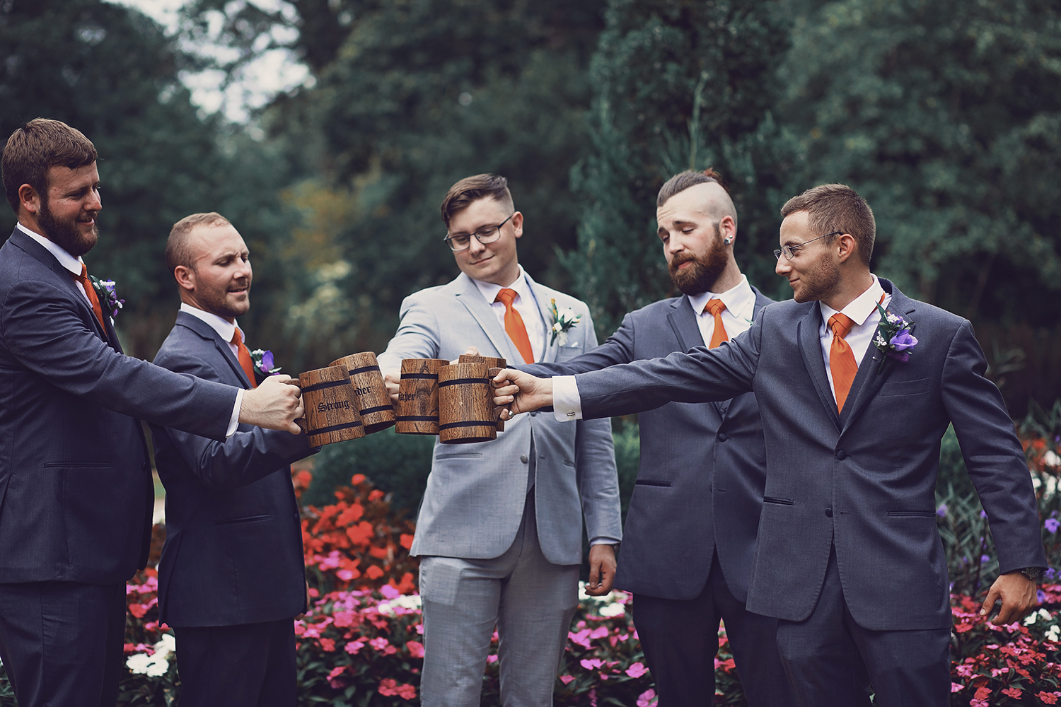 Fun wedding photography of Groom & Groomsmen Cheering