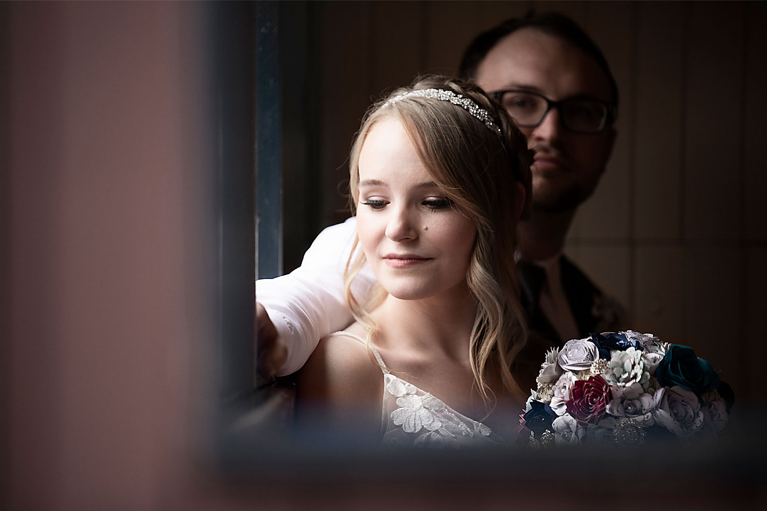 bride and groom in front of a window - St. Louis wedding photography